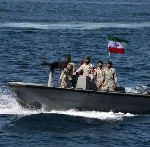 Iranian soldiers take part in National Persian Gulf day in the Strait of Hormuz on 30 April 2019