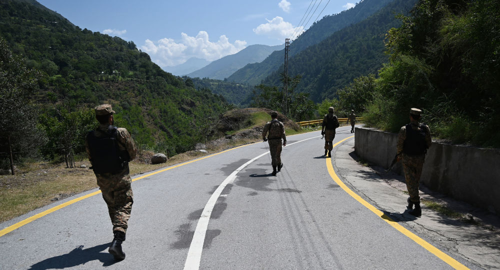 Pakistani troops patrol near the Line of Control (LoC) --- the de facto border between Pakistan and India -- in Chakothi sector, in Pakistan-administered Kashmir on August 29, 2019