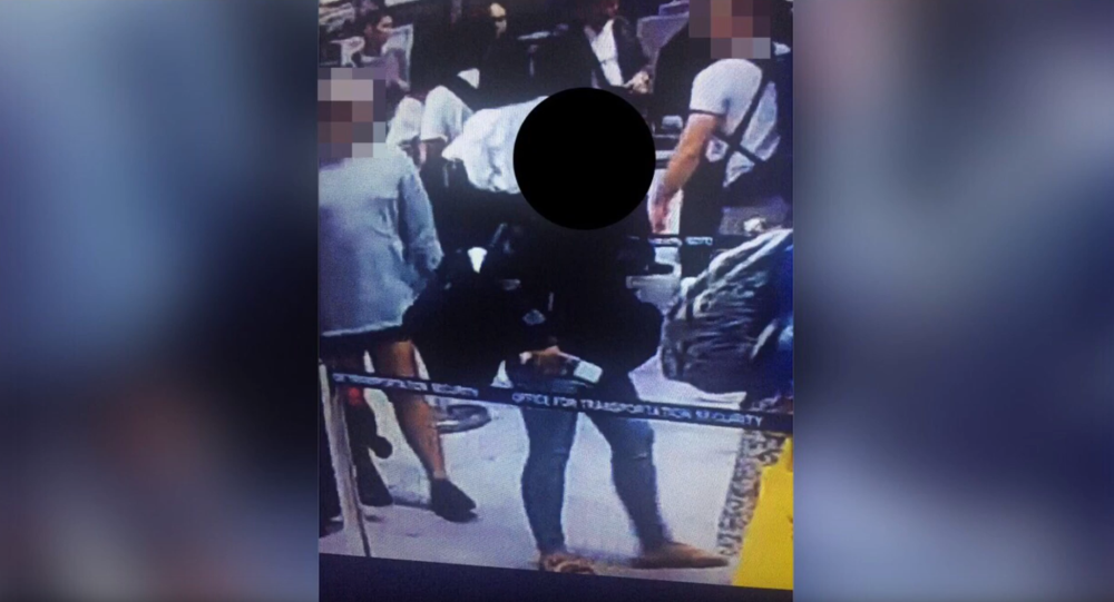 Woman spotted on Ninoy Aquino International Airport in Manila surveillance camera as she attempts to board the plane with a six-day-old baby stashed in her carry-on