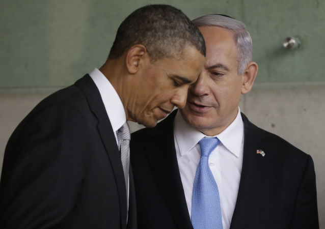 In this 22 March 2013 file photo, US President Barack Obama, left, listens to Israeli Prime Minister Benjamin Netanyahu during their visit to the Children's Memorial at the Yad Vashem Holocaust memorial in Jerusalem