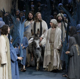 FILE - In this May 10, 2010 file photo Andreas Richter as Jesus, center on donkey, performs with laymen during a dress rehearsal of the passion play 2010 in the theatre of Oberammergau, southern Germany. More than 2,000 citizens of this Bavarian village participate in the century-old play of the suffering of Christ, staged every ten years and dating back to 1634