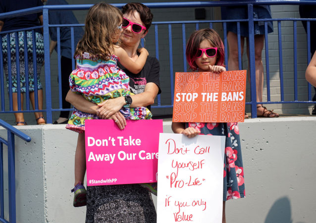 Abortion rights advocates attend a rally after a judge granted a temporary restraining order on the closing of Missouri's sole remaining Planned Parenthood clinic in St. Louis