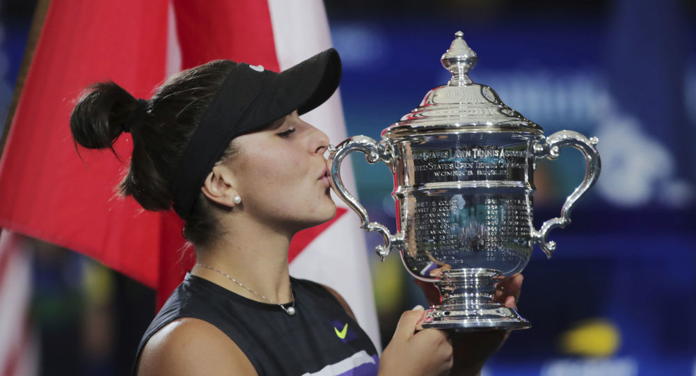 Bianca Andreescu, of Canada, kisses the championship trophy after defeating Serena Williams, of the United States, in the women's singles final of the U.S. Open tennis championships Saturday, Sept. 7, 2019, in New York.