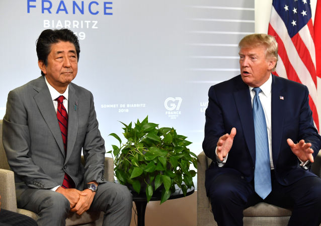Japan's Prime Minister Shinzo Abe (L) listens to US President Donald Trump during a bilateral meeting on the sidelines of the G7 summit in Biarritz, south-west France on August 25, 2019,