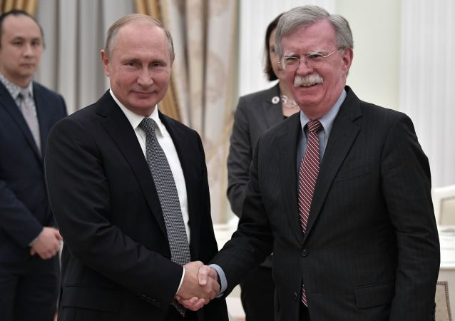 Russian President Vladimir Putin and US National Security Advisor John Bolton (right) during the meeting, October 23, 2018.
