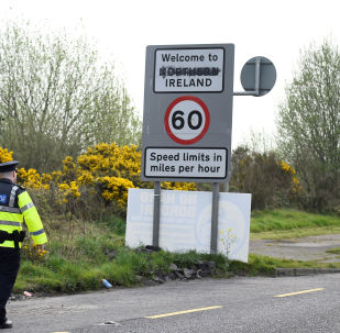 FILE PHOTO: Irish police officers patrol before U.S. House Speaker Nancy Pelosi's visit to the border between Ireland and Northern Ireland in Bridgend, Ireland, April 18, 2019