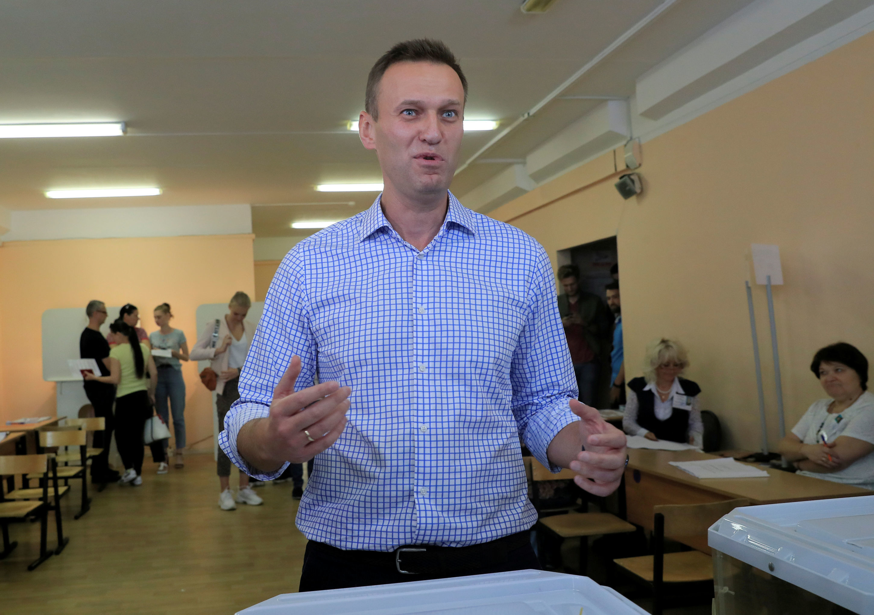 FILE PHOTO: Russian opposition leader Alexei Navalny stands near a ballot box at a polling station during the Moscow city parliament election in Moscow, Russia September 8, 2019