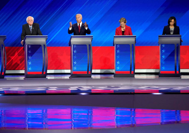 FILE PHOTO: Former Vice President Joe Biden speaks as South Bend Mayor Pete Buttigieg, Senator Bernie Sanders, Senator Elizabeth Warren and Senator Kamala Harris listen during the 2020 Democratic U.S. presidential debate in Houston, Texas, U.S., September 12, 2019