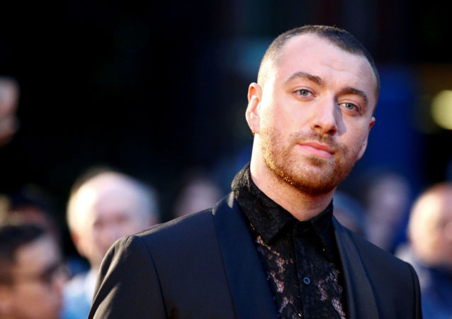 FILE PHOTO: Singer Sam Smith poses as they arrive to the GQ Men Of The Year Awards 2019 in London, 3 September 2019. REUTERS/Henry Nicholls