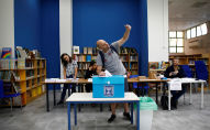 An man takes a selfie with his mobile phone as he casts his ballot in Israel's parliamentary election, at a polling station in Tel Aviv, Israel September 17, 2019