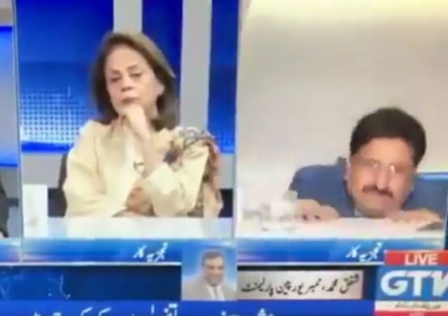 During a live discussion on Kashmir an analyst falls off his chair