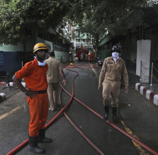Firefighters work to put out a fire that broke out at the All India Institute of Medical Sciences (AIIMS) hospital in New Delhi, India, Saturday, Aug. 17, 2019