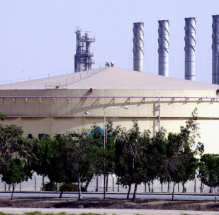 A fuel storage tank at the Saudi Aramco Shell oil refinery in Jubail, Saudi Arabia, in this photo taken Tuesday, June 1, 2004