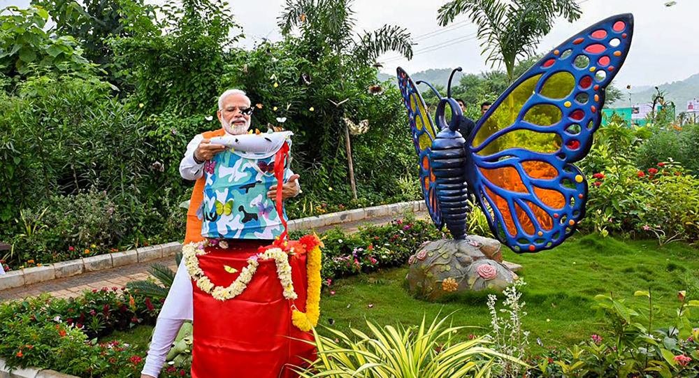 Prime Minister Narendra Modi releases butterflies as a part of his 69th birthday celebration, at Butterfly Garden in Kevadia, Tuesday, Sept. 17, 2019