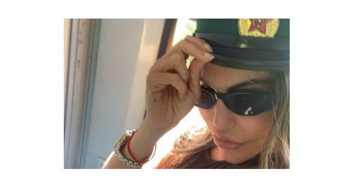Model Liziane Gutierrez steals North Korean soldier's hat and defies Kim Jong-un's laws in clips