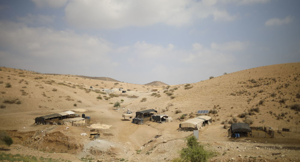 Palestinian Bedouin homes are seen in the Israeli-occupied West Bank, Wednesday, Sept. 11, 2019. Israeli Prime Minister Benjamin Netanyahu's election eve vow to annex the Jordan Valley if he is re-elected has sparked an angry Arab rebuke and injected the Palestinians into a campaign that had almost entirely ignored them. (AP Photo/Ariel Schalit)