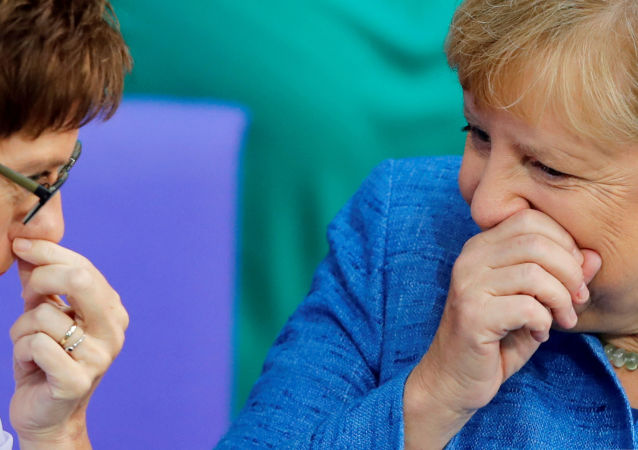 German Chancellor Angela Merkel talks with German Defence Minister Annegret Kramp-Karrenbauer during the budget debate in the Bundestag, the lower house of parliament in Berlin, Germany September 11, 2019.