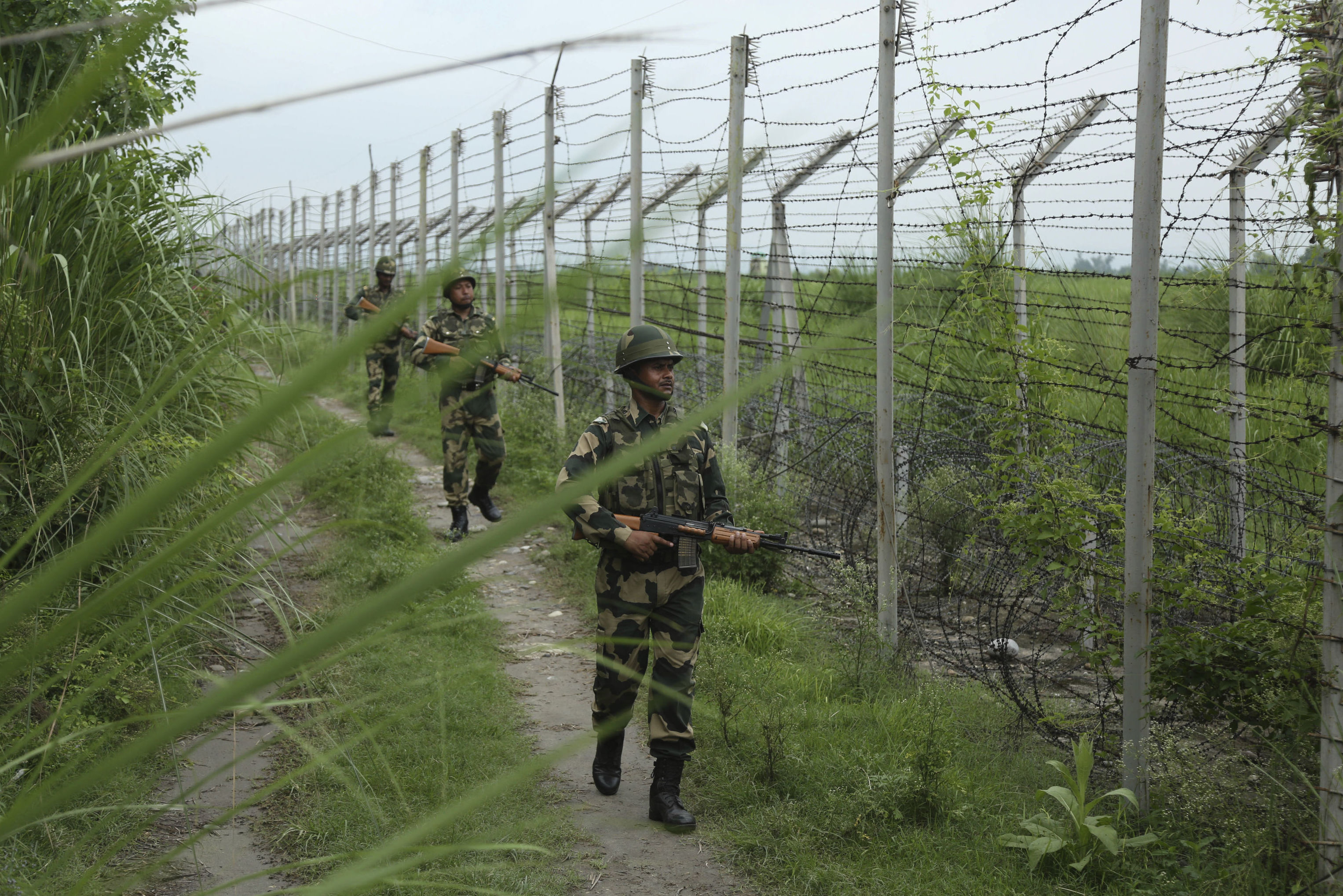 India's Border Security Force (BSF) soldiers patrol near the India Pakistan border fencing at Garkhal in Akhnoor, about 35 kilometers (22 miles) west of Jammu, India, Tuesday, Aug.13, 2019
