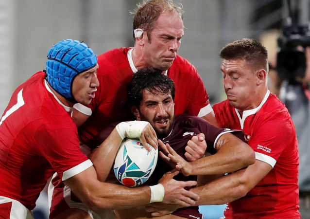Rugby Union - Rugby World Cup 2019 - Pool D - Wales v Georgia - City of Toyota Stadium, Toyota, Japan - September 23, 2019  Georgia's Giorgi Kveseladze in action with Wales' Justin Tipuric, Alun Wyn Jones and Hadleigh Parkes