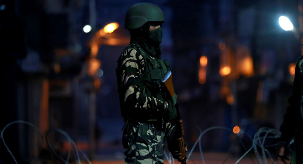 An Indian security force personnel stands guard in a street early morning during restrictions following scrapping of the special constitutional status for Kashmir by the Indian government, in Srinagar, September 27, 2019