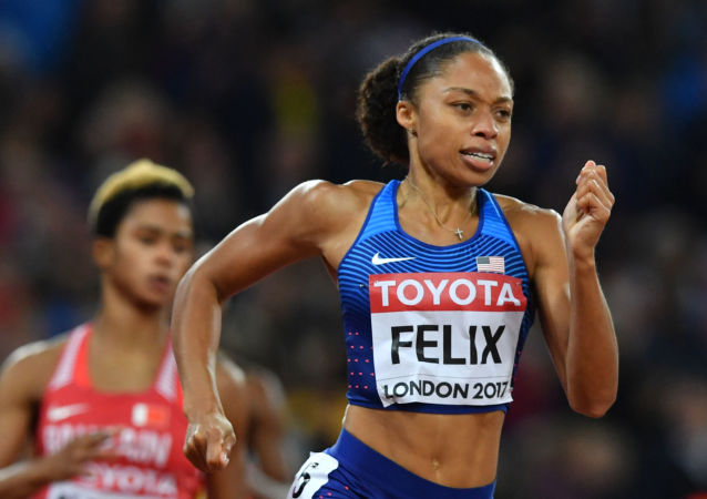 In this file photo taken on August 9, 2017 US athlete Allyson Felix competes in the final of the women's 400m athletics event at the 2017 IAAF World Championships at the London Stadium in London.
