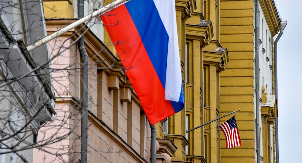 US national flag  waves on the building of the embassy of the United States of America (R) in Moscow on April 2, 2018
