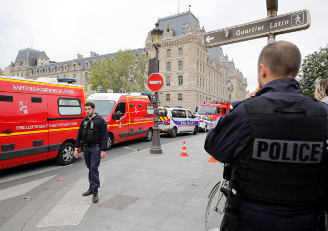 French police secure the area in front of the Paris Police headquarters in Paris, France, October 3, 2019