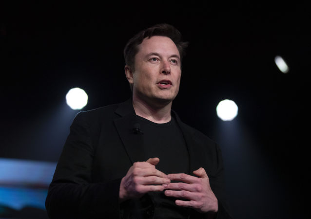 FILE - In this Thursday, March 14, 2019 file photo, Tesla CEO Elon Musk speaks before unveiling the Model Y at the company's design studio in Hawthorne, Calif.