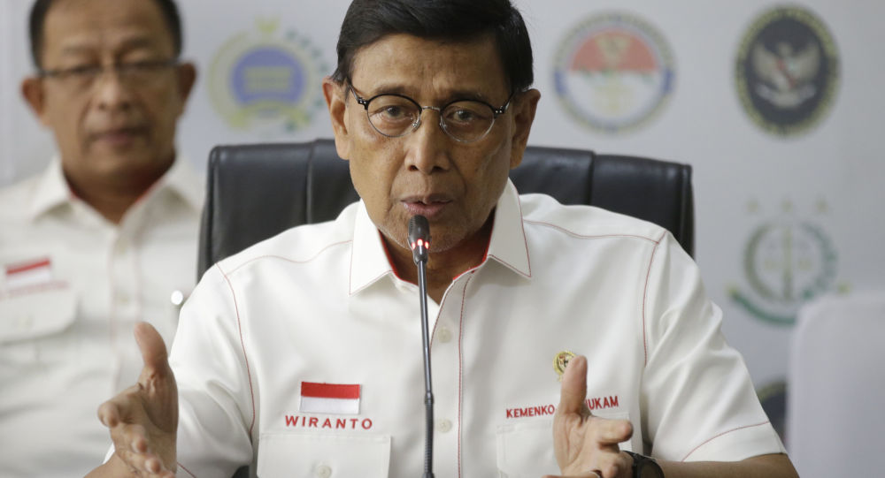 Indonesian Coordinating Minister for Politics, Law and Security Wiranto gestures as he speaks during a press conference in Jakarta, Indonesia, Tuesday, Sept. 24, 2019