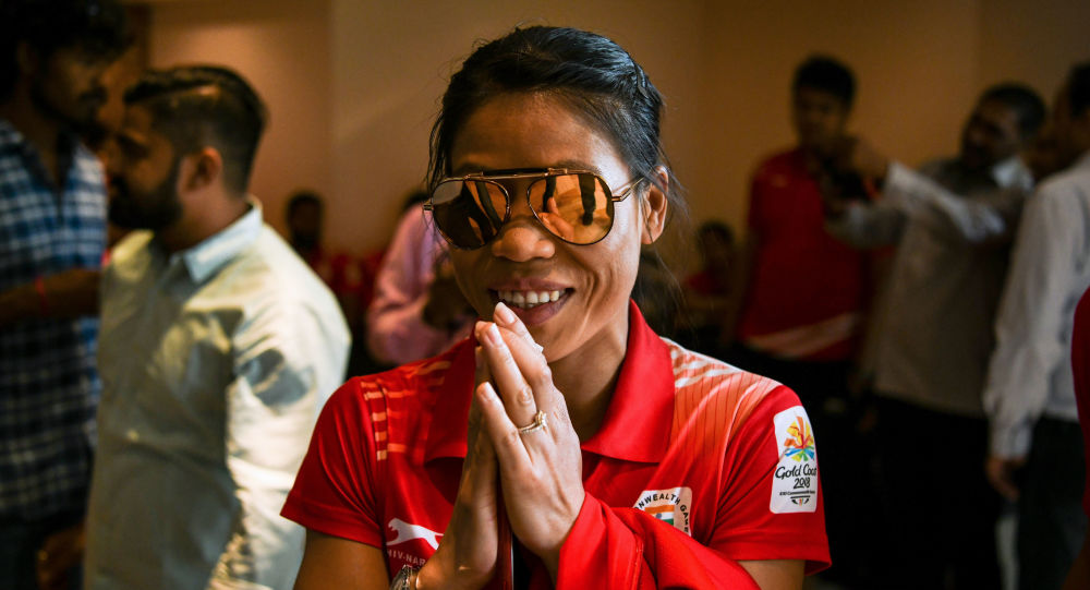 Indian boxer Mary Kom gestures as she arrives at a ceremony for the victorious Indian boxing contingent at the 2018 Commonwealth Games, in New Delhi on April 17, 2018