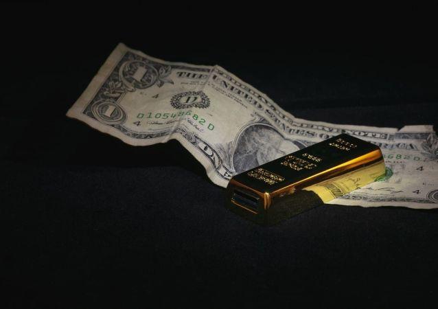 Dollar  and gold ingot