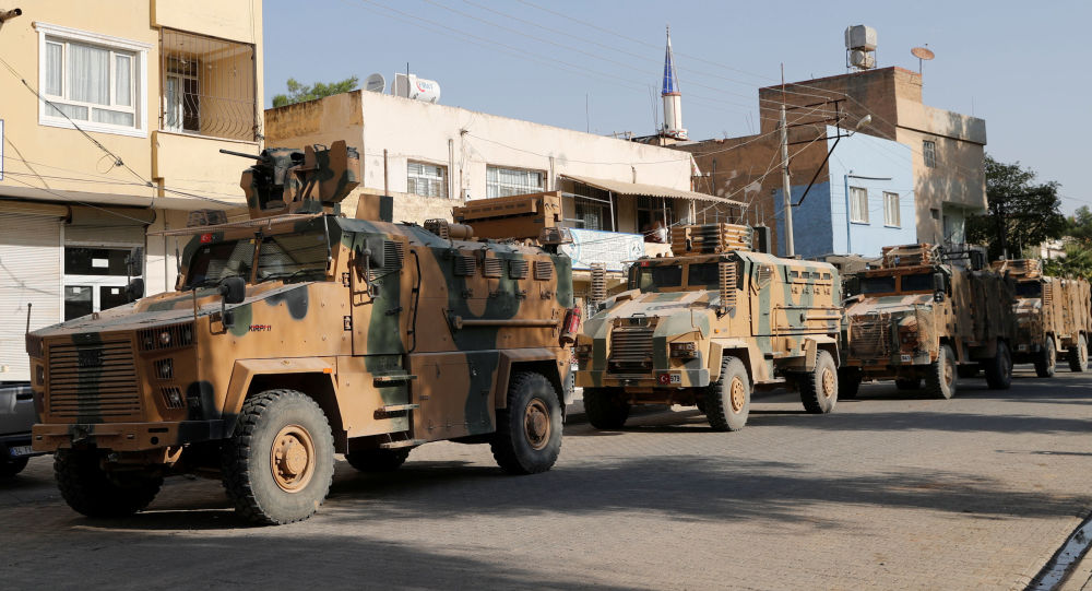 Turkish military vehicles drive to cross into Syria in the Turkish border town of Ceylanpinar in Sanliurfa province, Turkey, October 11, 2019