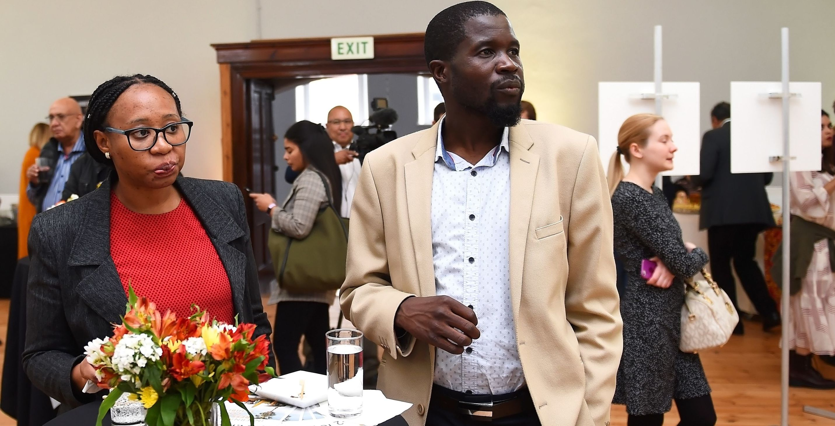 Guests at the opening of the exhibition of the Andrei Stenin Photo Contest winners in Cape Town