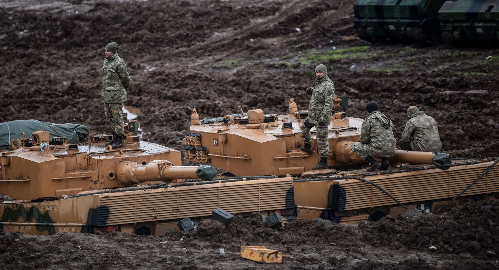 German-made Turkish Leopard 2A4 battle tanks are stationed in a field near the Syrian border at Hassa, in Hatay province on 25 January 2018, as part of operation Olive Branch, Turkey's attack on the Kurdish enclave of Afrin.