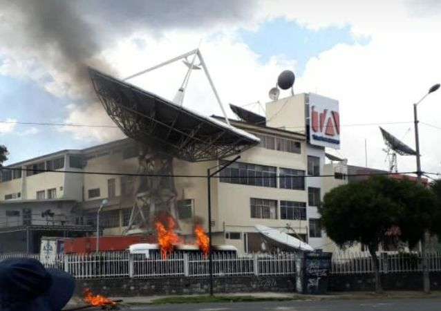 The building of Ecuadorian TV channel Teleamazonas attacked by alleged protesters.