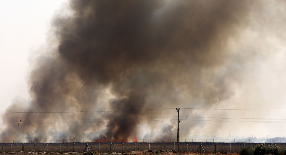 Smoke billows from fires where Turkish forces have struck in Tel Abyad, Syria