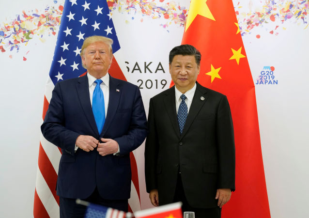 U.S. President Donald Trump poses for a photo with China's President Xi Jinping before their bilateral meeting during the G20 leaders summit in Osaka, Japan, June 29, 2019
