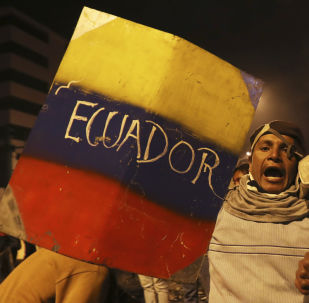 Indigenous and protesters celebrate the announcement that the government cancelled an austerity package that triggered violent protests, in Quito, Ecuador, Sunday, Oct. 13, 2019. Ecuadorian President Lenin Moreno and leaders of the country's indigenous peoples have struck a deal to cancel the disputed austerity package and end nearly two weeks of protests that have paralyzed the economy and left several people dead