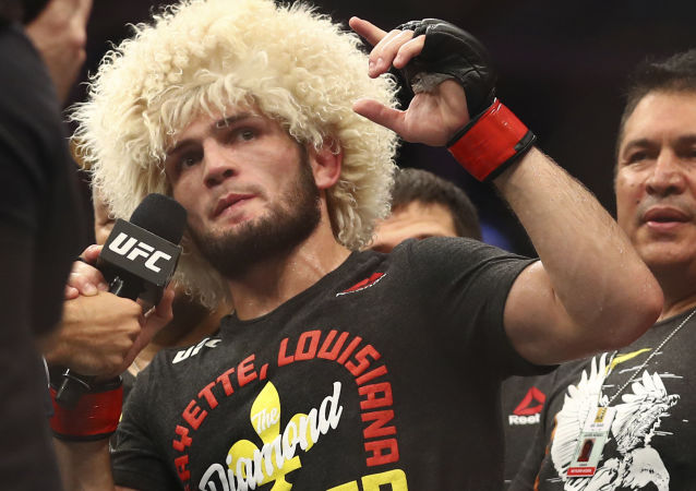 Russian UFC fighter Khabib Nurmagomedov speaks after wining against UFC fighter Dustin Poirier, of Lafayette, La., during Lightweight title mixed martial arts bout at UFC 242, in Yas Mall in Abu Dhabi, United Arab Emirates, Saturday , Sept.7 2019