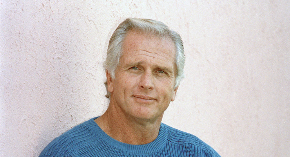 """his Dec. 28, 1987 file photo shows former """"Tarzan"""" actor Ron Ely during an interview in Los Angeles. A woman was killed at Ely's Southern California home and sheriff's deputies fatally shot a suspect on the property, authorities said Wednesday, Oct. 16, 2019. A Santa Barbara County sheriff's office statement does not identify any of those involved but notes that a disabled elderly man living at the home was taken to a hospital for evaluation. The deaths occurred Tuesday night in Hope Ranch, a suburb of luxury homes outside Santa Barbara."""