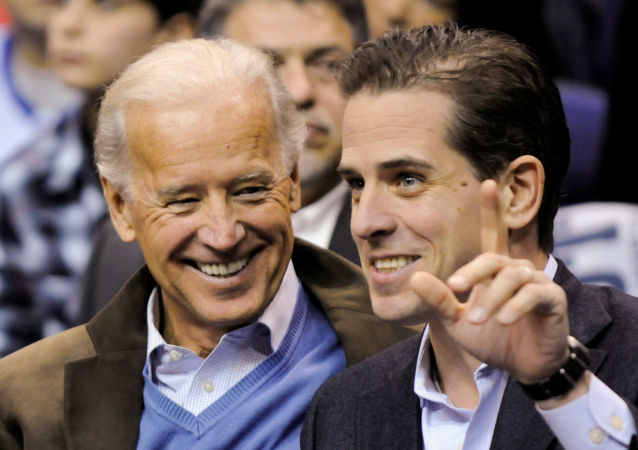 U.S. Vice President Joe Biden and his son Hunter Biden attend an NCAA basketball game between Georgetown University and Duke University in Washington, U.S., January 30, 2010.