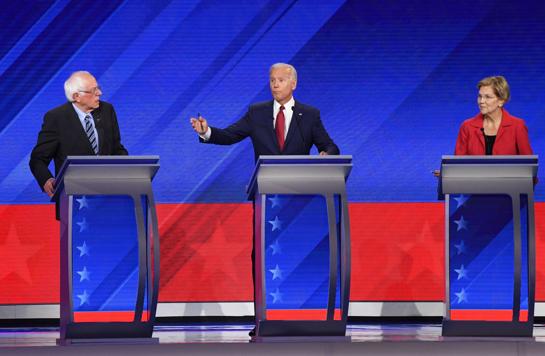 Democratic presidential hopefuls Vermont Senator Bernie Sanders (L), Former Vice President Joe Biden (C) and Massachusetts Senator Elizabeth Warren (R) speak during the third Democratic primary debate of the 2020 presidential campaign