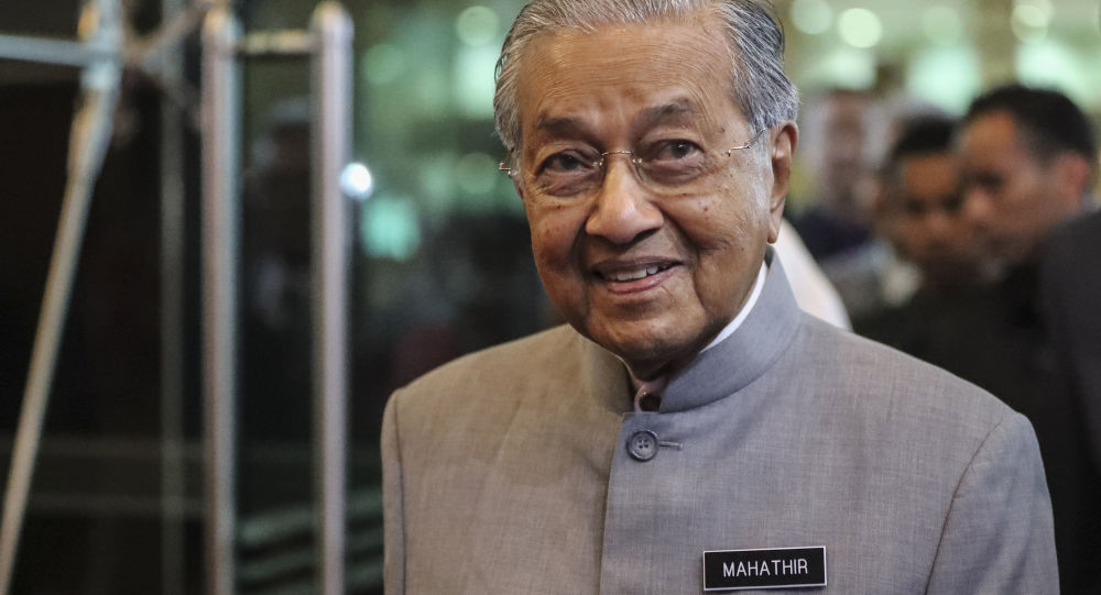 Malaysian Prime Minister Mahathir Mohamad arrives upon delivering a televised speech to the nation in conjunction with the coalition's first anniversary in power in Putrajaya, Malaysia, Thursday, May 9, 2019