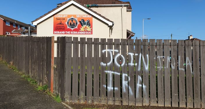 IRA graffiti and a mural criticising the police close to the scene on the Creggan estate in Derry where Lyra McKee was shot dead in April 2019
