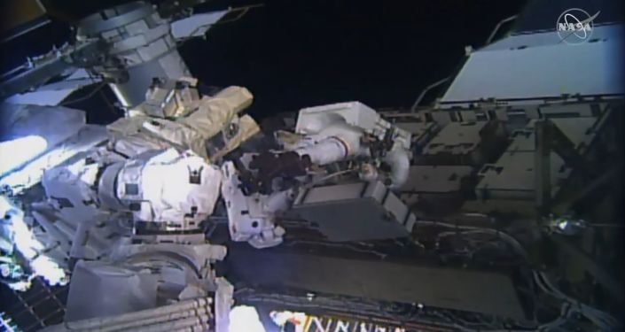 This image taken from NASA TV shows, astronaut Christina Koch (C L) and Jessica Meir (C R) during their spacewalk at the International Space Station on October 18, 2019.