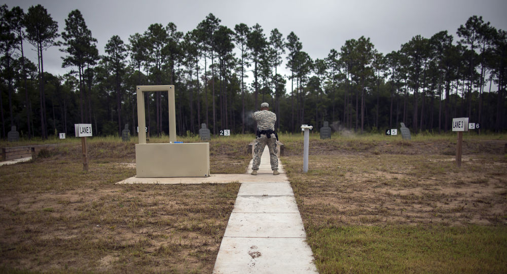 A member of the 139th Military Police Company shoots his 9mm Beretta M9, during a qualifying exercise at a range, Tuesday, Sept. 29, 2015, in Fort Stewart, Ga.  The Army wants to replace its M9, a 9mm semi-automatic handgun adopted during the Cold War. The new gun also will replace the smaller M11.