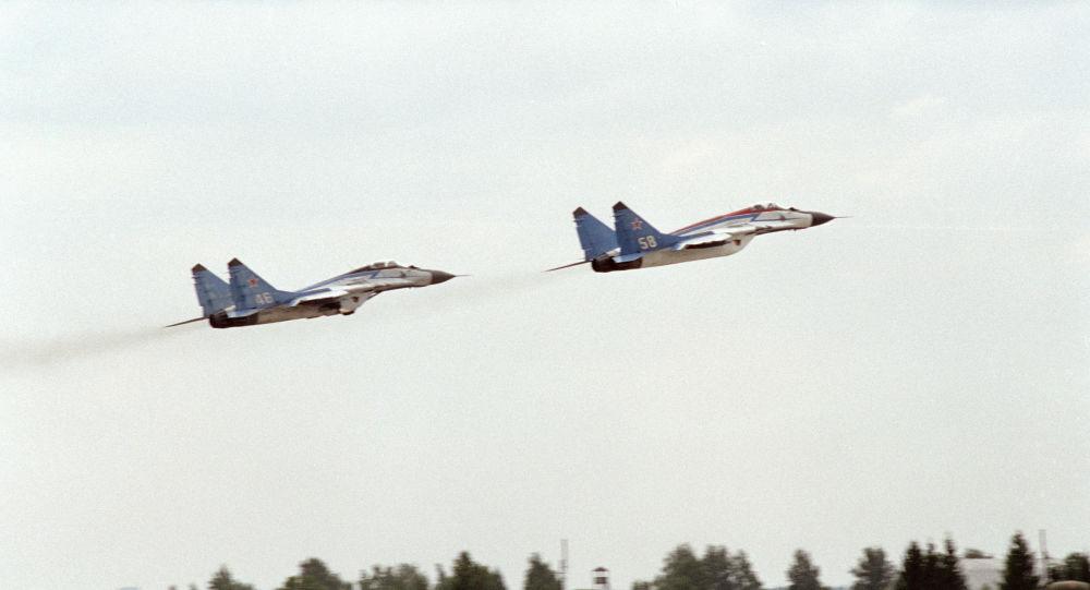 MiG-25 warplanes take off during a parade rehearsal