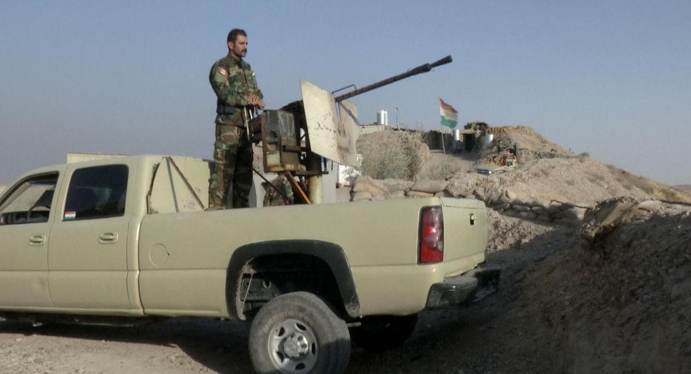 Militiaman of the Kurdistan Freedom Party stands behind his truck-mounted machine gun (File)