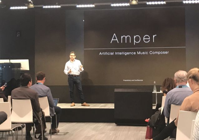 Drew Silverstein, the CEO and co-founder of Amper Music presents the app at Machines + Media