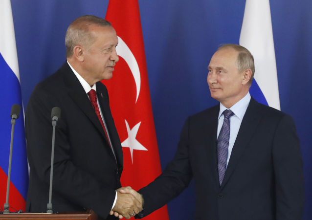Turkish President Recep Tayyip Erdogan, left, shakes hands with Russian President Vladimir Putin during a joint news conference following their talks on the sidelines of the MAKS-2019 International Aviation and Space Show in Zhukovsky, outside Moscow, Russia, Tuesday, Aug. 27, 2019. Turkish President is on a short working visit in Russia.